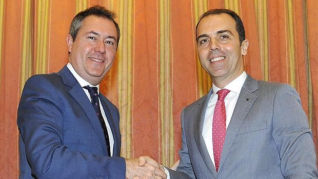 Juan Espadas y Javier Millán.